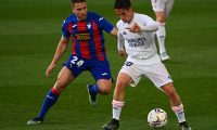 Eibar's Portuguese defender Kevin Rodrigues (L) challenges Real Madrid's Spanish midfielder Sergio Arribas during the Spanish League football match between Real Madrid CF and SD Eibar at the Alfredo di Stefano stadium in Valdebebas on the outskirts of Madrid on April 3, 2021. (Photo by GABRIEL BOUYS / AFP)