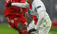 Paris Saint-Germain's French forward Kylian Mbappe goes down after a challange by Bayern Munich's Austrian defender David Alaba during the UEFA Champions League quarter-final first leg football match between FC Bayern Munich and Paris Saint-Germain (PSG) in Munich, southern Germany, on April 7, 2021. (Photo by Christof STACHE / AFP)