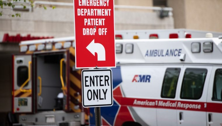 Ambulances sit outside the emergency room at Washington Hospital Center during the COVID-19, known as coronavirus, pandemic in Washington, DC, April 7, 2020. (Photo by SAUL LOEB / AFP)