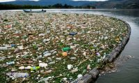 View of garbage washed away by rains and held by a floating barrier installed in one of the tributaries of the Lake in Amatitlan, 30 kms south of Guatemala City, on May 29, 2020 amid the Covid-19 coronavirus pandemic. (Photo by Johan ORDONEZ / AFP)