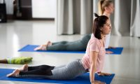 Nyiregyhaza (Hungary), 03/05/2021.- Women do yoga in a gym in Nyiregyhaza, Hungary, 03 May 2021. As the number of the people vaccinated against the new coronavirus Covid-19 reached four million in Hungary on 30 April, restrictions to help curb the spread of the virus have been eased, allowing people in possession of a valid vaccination certificate to visit cinemas, gyms, baths, museums as well restaurants and bars with indoor tables. (Cine, Hungría) EFE/EPA/Attila Balazs HUNGARY OUT