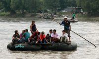 """Locals and Central American migrants use a makeshift raft across the Suchiate river from Tecun Uman in Guatemala, to Ciudad Hidalgo in Chiapas State, Mexico, on June 11, 2019. - Mexico's Foreign Minister Marcelo Ebrard said Mexico will discuss a """"safe third country"""" agreement with the US -- in which migrants entering Mexican territory must apply for asylum there rather than in the US -- if the flow of undocumented immigrants continues. (Photo by QUETZALLI BLANCO / AFP)"""