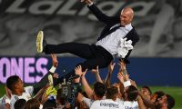 (FILES) In this file photo taken on July 16, 2020 Real Madrid's player toss Real Madrid's French coach Zinedine Zidane after winning the Liga title after the Spanish League football match between Real Madrid CF and Villarreal CF at the Alfredo di Stefano stadium in Valdebebas, on the outskirts of Madrid. - According to media reports, Zinedine Zidane has resigned as Real Madrid manager with immediate effect, just days after the club were beaten to the La Liga title by Atletico Madrid. The Frenchman's reported departure comes at the end of a disappointing campaign for the 13-time European champions, who also lost to Chelsea in the Champions League semi-finals as they failed to win a trophy for the first time in 11 seasons. (Photo by GABRIEL BOUYS / AFP)