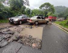 Las intensas lluvias también dañaron el asfalto en el km 191.5 de la ruta Cito-Zarco, ingreso al Nuevo Palmar, Quetzaltenango. (Foto Prensa Libre: Conred)