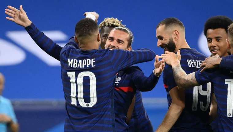 Mbappé, Griezmann y Benzema, el tridente temido en Europa. (Foto Prensa Libre: AFP)
