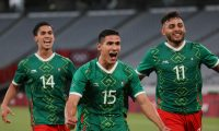Mexico's forward Uriel Antuna (C) celebrates with Mexico's forward Alexis Vega (R) and Mexico's midfielder Erick Aguirre (L) after scoring the third goal during the Tokyo 2020 Olympic Games men's group A first round football match between Mexico and France at Tokyo Stadium in Tokyo on July 22, 2021. (Photo by Mariko Ishizuka / AFP)