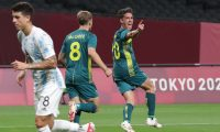Australia's Lachlan Wales (C) celebrates scoring during the Tokyo 2020 Olympic Games men's group C first round football match between Argentina and Australia at the Sapporo Dome in Sapporo on July 22, 2021. (Photo by ASANO IKKO / AFP)