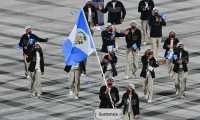 Guatemala's flag bearer Isabella Maegli and Guatemala's flag bearer Juan Maegli and their delegation parade during the opening ceremony of the Tokyo 2020 Olympic Games, at the Olympic Stadium, in Tokyo, on July 23, 2021. (Photo by Martin BUREAU / AFP)