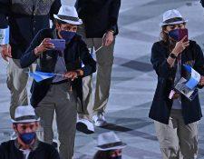 La delegación de Guatemala desfila en la ceremonia inaugural de los Juegos Olímpicos de Tokio. Foto Prensa Libre: AFP.