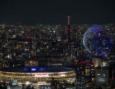 Mil 824 drones formaron un globo terráqueo en la inauguración de los Juegos Olímpicos de Tokio 2020. Foto Prensa Libre: AFP.