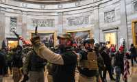 (FILES) In this file photo taken on January 6, 2021 Supporters of US President Donald Trump enter the US Capitol's Rotunda, in Washington, DC. - A Florida man who breached the US Senate chamber during the violent January 6 Capitol riots was jailed for eight months on July 7, 2021, in the closely-watched first sentencing hearing for someone convicted of a felony over the attack. (Photo by Saul LOEB / AFP)