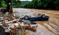 Schuld (Germany), 15/07/2021.- A destroyed car lies in the Ahr river after heavy flooding in Schuld, Germany, 15 July 2021. Large parts of Western Germany were hit by heavy, continuous rain in the night to 15 July resulting in local flash floods that destroyed buildings and swept away cars. (Inundaciones, Alemania) EFE/EPA/SASCHA STEINBACH