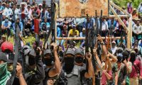 """Members of the new self-defence group called """"El Machete"""", that intends to combat criminal groups in the San Jose Tercero indigenous Tzotzil community, parade during their presentation in the municipality of Pantelho, Chiapas State, Mexico on July 18, 2021. (Photo by ISAAC GUZMAN / AFP)"""