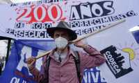 Integrantes de Codeca protestarán el 15 de septiembre en contra de la celebración del Bicentenario. (Foto Prensa Libre: AFP)