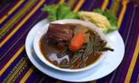 """View of a plate with """"Pepian"""", a traditional Guatemalan dish, in Guatemala City on September 10, 2015. The """"Pepian"""" was declared Intangible Cultural Heritage of Guatemala in 2007. AFP PHOTO / Johan ORDONEZ"""