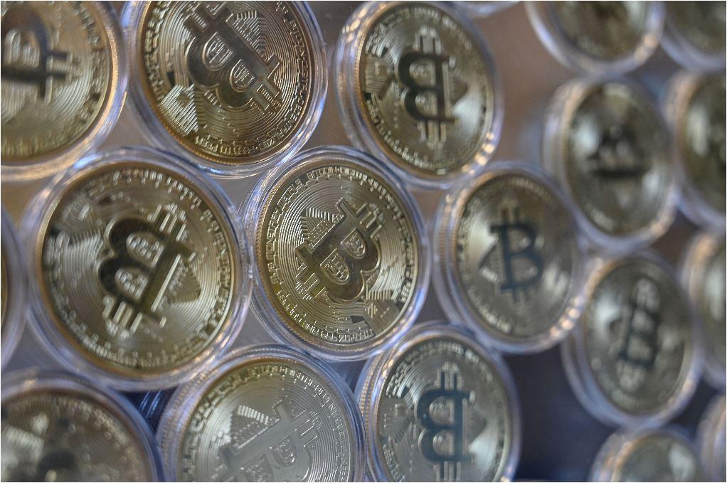 Pl Plus organizó el conversatorio Los negocios después del bitcóin en El Salvador. (Foto Prensa Libre: AFP)