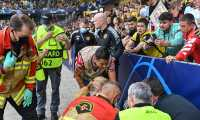 Manchester United's Portuguese striker Cristiano Ronaldo apologises after he accidently shot a ball in a steward's head while warming up prior to the UEFA Champions League Group F football match between Young Boys and Manchester United at Wankdorf stadium in Bern, on September 14, 2021. (Photo by Fabrice COFFRINI / AFP)