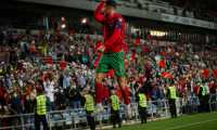Portugal's forward Cristiano Ronaldo celebrates after scoring a goal during the FIFA World Cup Qatar 2022 qualification Group A football match between Portugal and Luxembourg at the Estadio Algarve in Loule, near Faro, south of Portugal, on October 12, 2021. (Photo by CARLOS COSTA / AFP)